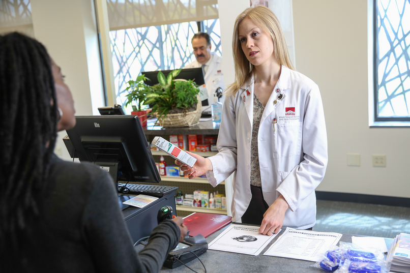A patient receives a prescription at College Parkside Pharmacy in Albany