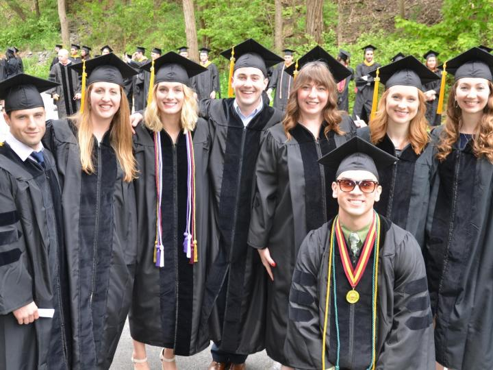 students in cap and gown at ACPHS commencement
